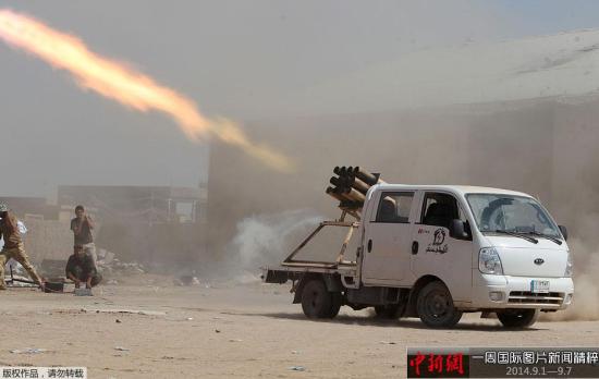 9月3日,伊拉克民兵用火箭攻击伊斯兰国所占城市外围。