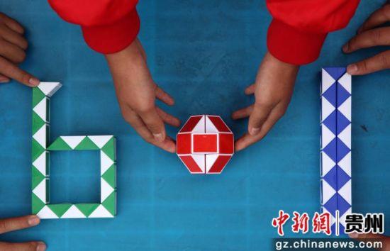 """""""六一""""国际儿童节临近,贵州省毕节市黔西县举行丰富多彩的活动,让孩子们在欢声笑语中迎接节日的到来。(史开心 摄)"""